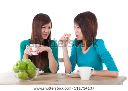 asian girls eating on table - stock photo