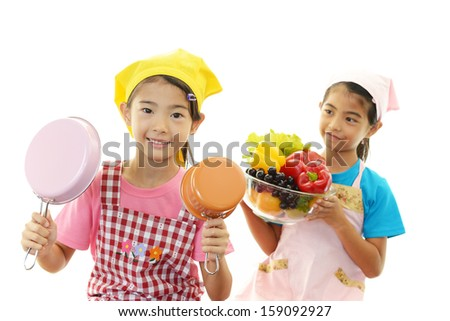 Asian girls who enjoy cooking together - stock photo