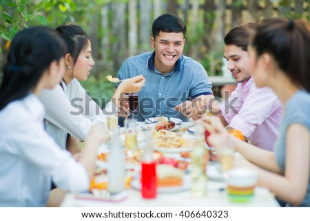 Asian group eating the evening they were talking fun - stock photo