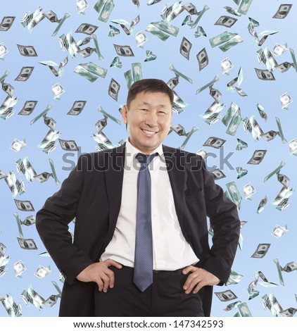 Asian happy businessman and flying dollar banknotes against blue sky - stock photo