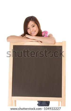 Asian High school girl student standing  by blackboard - stock photo