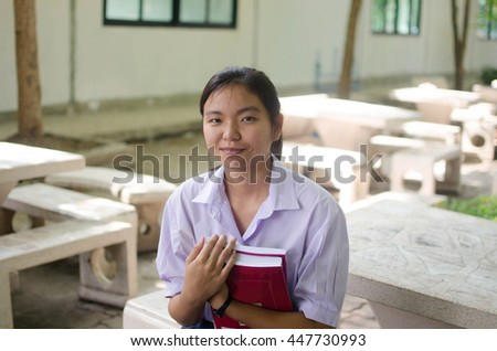 asian high student  girl in white uniform.student concept.focus on face and blur background. - stock photo