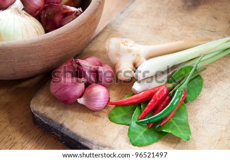 asian hot and spicy food ingredient with onions in wooden bowl - stock photo