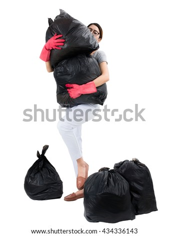 Asian housewife holding garbage bags, isolated on white background. - stock photo