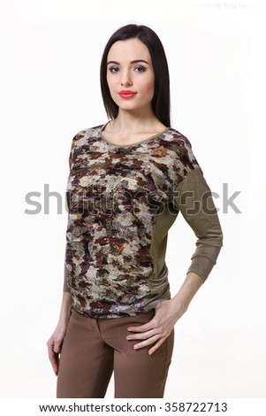 asian indian fashion model in khaki military print sleeveless blouse casual trousers and trainers close up portrait isolated on white - stock photo