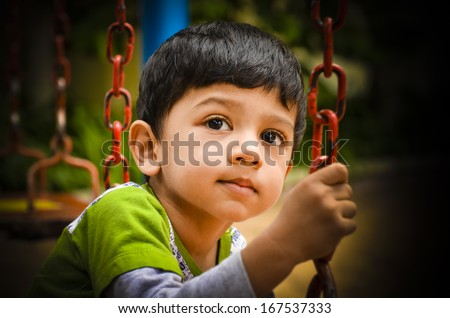 Asian indian little kid with an innocent look - stock photo