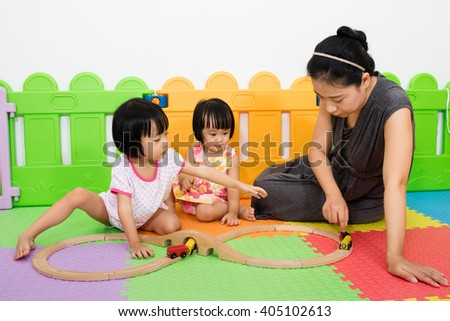 Asian Kids and Mother Playing Together at Playground - stock photo