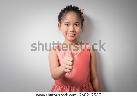 asian kids with a like hand - stock photo