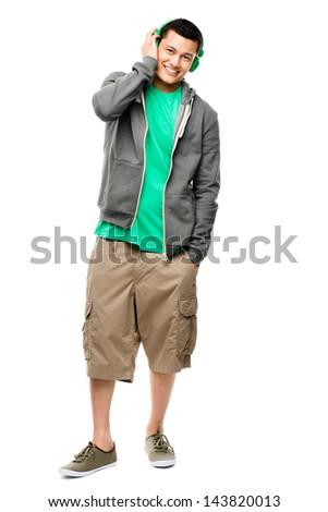 Asian listening to music student heaphones white background - stock photo