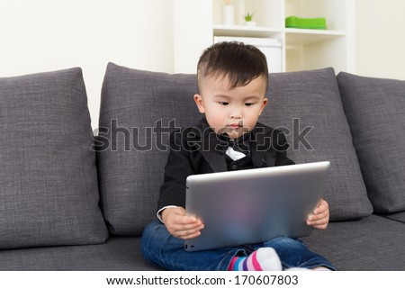 Asian little boy using tablet computer - stock photo