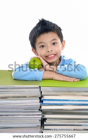Asian little boy with set of books - stock photo