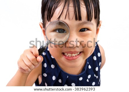 Asian Little Chinese Girl Holding Magnifying Glass isolated on White Background - stock photo