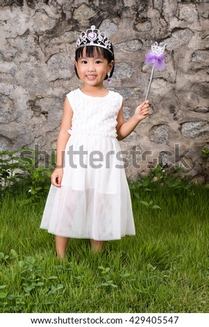 Asian Little Chinese Girl in Princess Costume at outdoor - stock photo