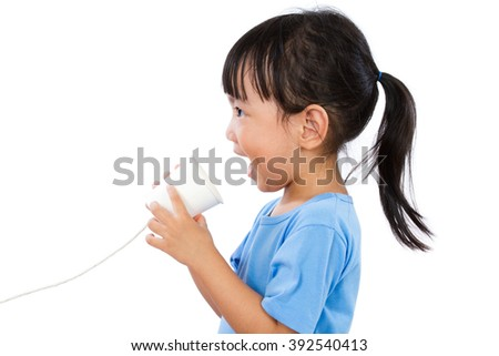 Asian Little Chinese Girl Playing with Paper Cup isolated on White Background - stock photo