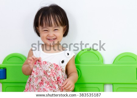 Asian Little Chinese Girl Smiling at Home or Kindergarten - stock photo