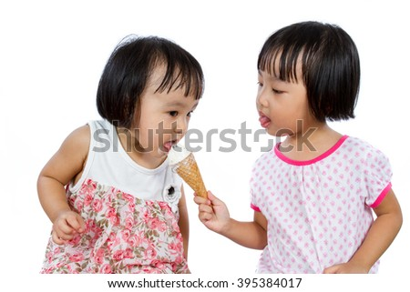 Asian Little Chinese Girls Eating Ice Cream isolated on White Background - stock photo