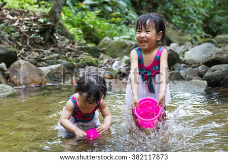 Asian Little Chinese Girls Playing in Creek in the Forest - stock photo
