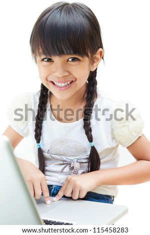 Asian little girl is sitting with her laptop computer, Isolated over white - stock photo
