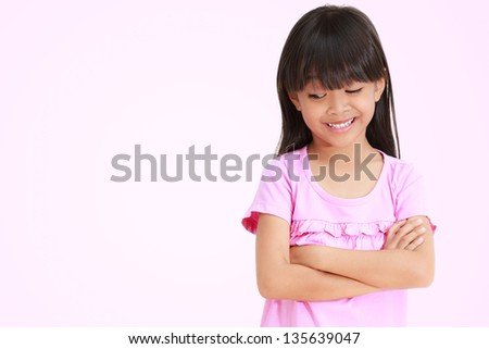 Asian little girl looking down - stock photo