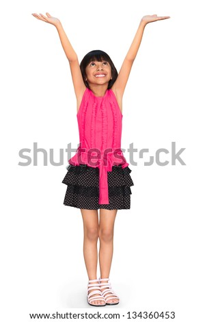 Asian little girl standing and holds hands up, Isolated over white with clipping path - stock photo