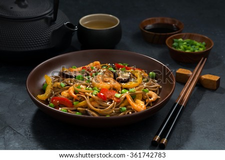 Asian lunch. Buckwheat noodles with seafood, closeup - stock photo