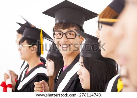 asian male college graduate at graduation with classmates - stock photo