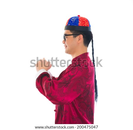 asian male with traditional chinese new year greeting gong xi fa cai - stock photo