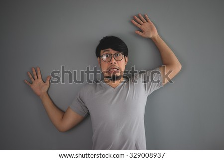 Asian man being pushed to the wall. - stock photo