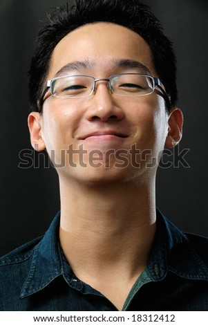 Asian man giving smurky smile - stock photo