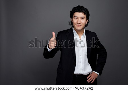 Asian man holding hand positive - stock photo