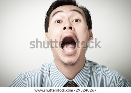asian man opening the mouth. - stock photo