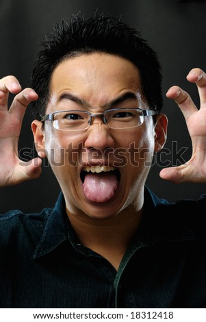 Asian man scaring you - stock photo