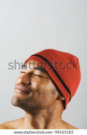 Asian man wearing hat with eyes closed - stock photo