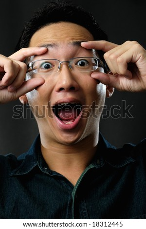 Asian man with surprised face - stock photo