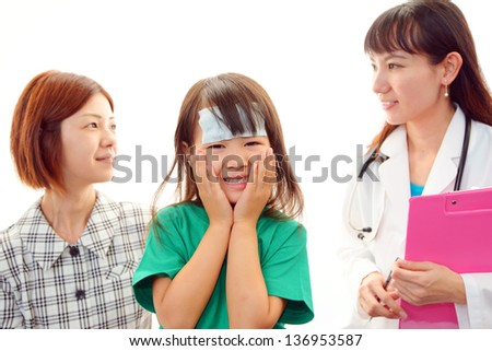 Asian medical doctor and child. - stock photo