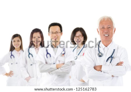 Asian medical team, expertise senior and mature doctors leading young practitioners, standing isolated white background - stock photo