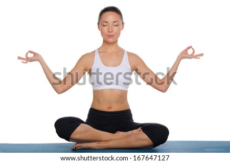 Asian meditating in lotus position isolated on white - stock photo