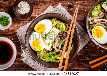 Asian miso ramen noodles with eggs, tofu and shimeji mushrooms - stock photo