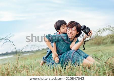 Asian mother and Son Having Fun in garden,thailand - stock photo