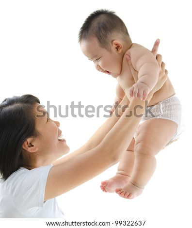 Asian mother playing with her baby boy - stock photo
