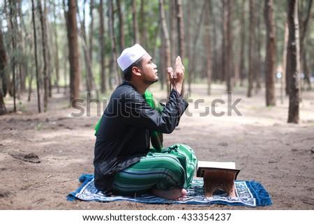 Asian muslim man praying - stock photo