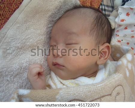 asian new born baby sleeping  - stock photo