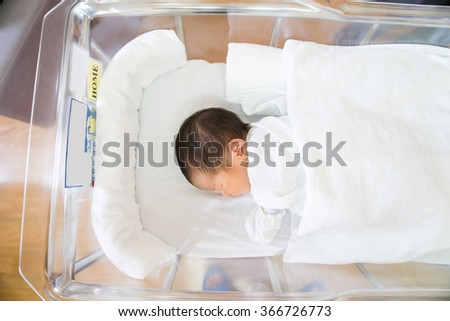 Asian newborn baby in hospital, delivery room - stock photo