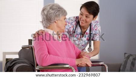 Asian nurse talking with Senior patient - stock photo