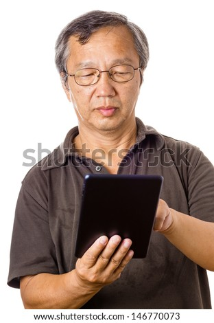 Asian old man using tablet - stock photo