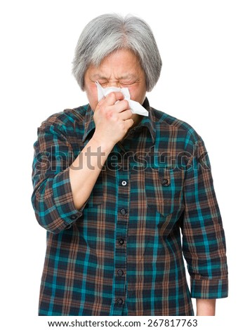 Asian old woman feel sneeze - stock photo