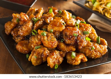Asian Orange Chicken with Green Onions for Dinner - stock photo