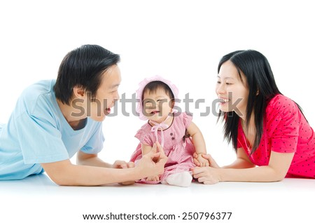 Asian parent playing with their 6 months old baby girl - stock photo