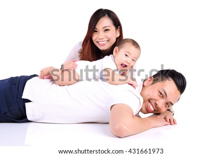 Asian parent playing with their six months old baby boy - stock photo