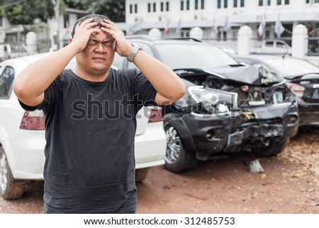 Asian people of desperate man after car crash - stock photo